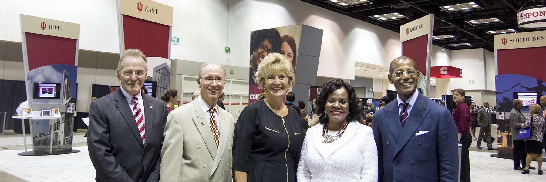 Speakers stand together at the Indiana Black Expo.