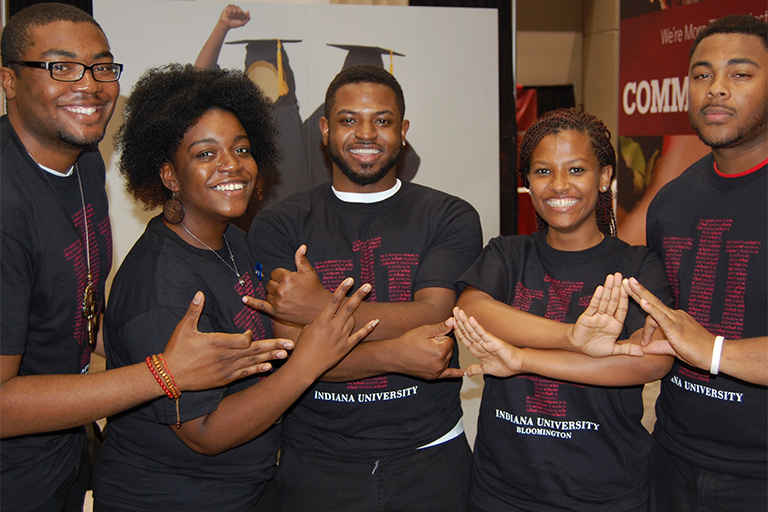 Volunteers represent IU at the IBE Summer Celebration.